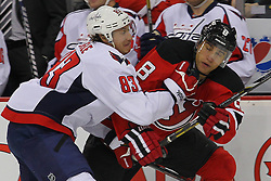 Jan 25, 2013; Newark, NJ, USA; Washington Capitals center Jay Beagle (83) hits New Jersey Devils right wing Dainius Zubrus (8) during the first period at the Prudential Center.
