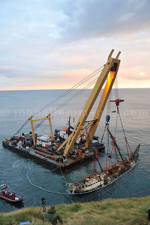 The Astrid wreck being raised by a special crane. <br /> Picture. John Allen