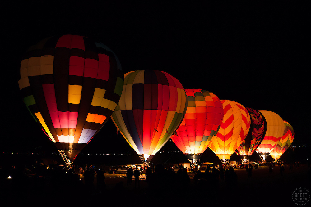 """""""Dawn Patrol 7"""" - Photograph of glowing hot air balloons getting ready to launch for Dawn Patrol at the 2012 Great Reno Balloon Race."""