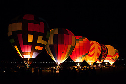 """Dawn Patrol 7"" - Photograph of glowing hot air balloons getting ready to launch for Dawn Patrol at the 2012 Great Reno Balloon Race."