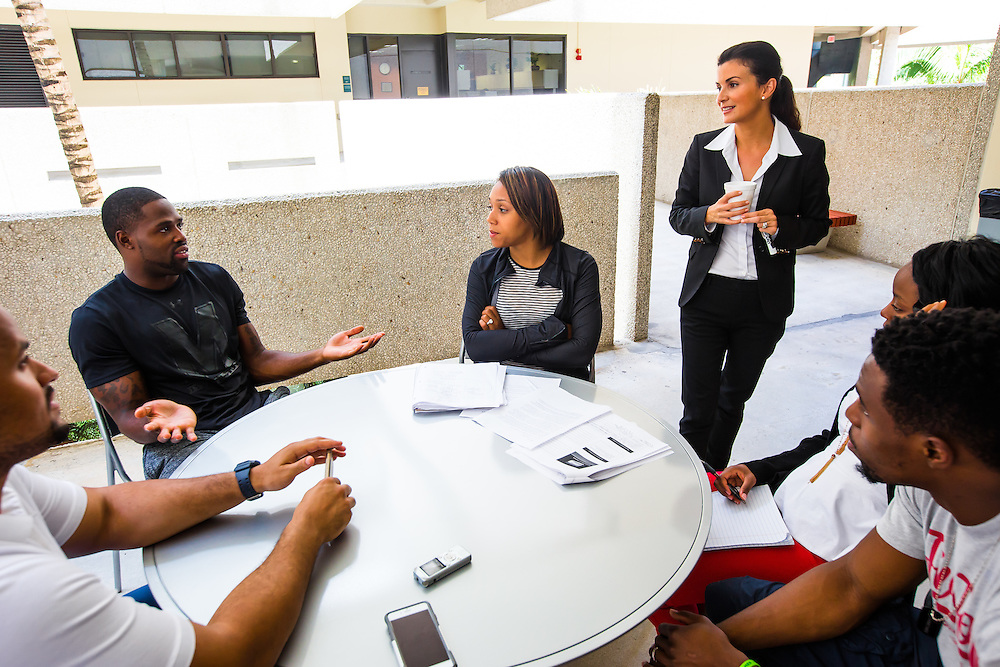MIAMI, FL - June 24, 2015 -- NFL wide receiver Torrey Smith and his wife, Chanel, participate in a Legal & Ethical Implications of Executive Decision Making class taught by Professor Patricia Abril at the University of Miami as part of their Miami Executive MBA for Artists & Athletes program on Wednesday, June 24, 2015.  (PHOTO / CHIP LITHERLAND)