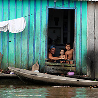South America, Brazil, Amazon.  Daily life for a family on the Amazon River.