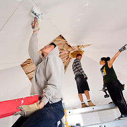 032613       Brian Leddy<br /> Vi Nguyen, a volunteer student from southern California, spackles drywall in a hogan in Cameron, Ariz. Tuesday, March 26. The hogan is being constructed for Thomasina Nez and her seven children.
