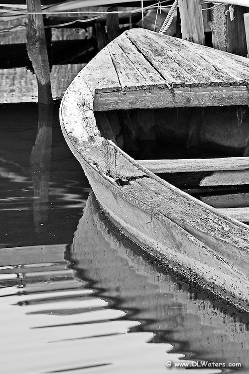 Old boat and dock at hog quarter along Currituck sound.  Photographed in black and white.