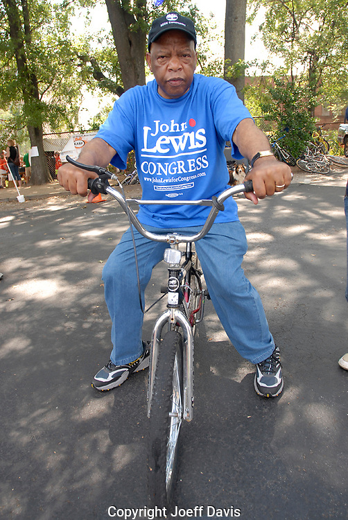 ATLANTA, GA - MAY, 2008: Georgia Representative John Lewis demonstrates his biking skills, at 68 years old they are a little rusty. Nevertheless,  John Lewis is campaigning hard, its his first contested race in 16 years and he faces political novice Rev. Markel Hutchins. This stop at Sopo Bike Coop in East Atlanta is one of many he will make this day.