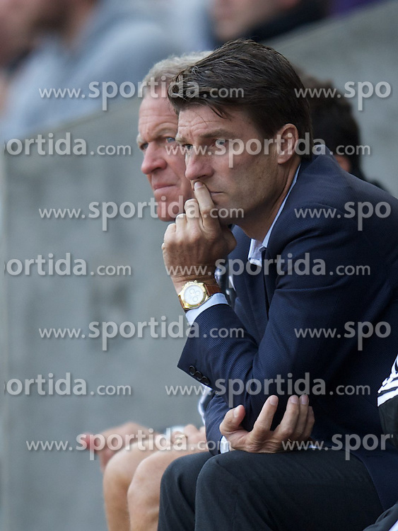 22.09.2012, Liberty Stadion, Swansea, ENG, Premier League, Swansea City vs FC Everton, 5. Runde, im Bild Swansea City's manager Brian Laudrup watches his side lose 3-0 to Everton during the English Premier League 5th round match between Swansea City AFC and Everton FC at the Liberty Stadium, Swansea, Great Britain on 2012/09/22. EXPA Pictures © 2012, PhotoCredit: EXPA/ Propagandaphoto/ David Rawcliff..***** ATTENTION - OUT OF ENG, GBR, UK *****