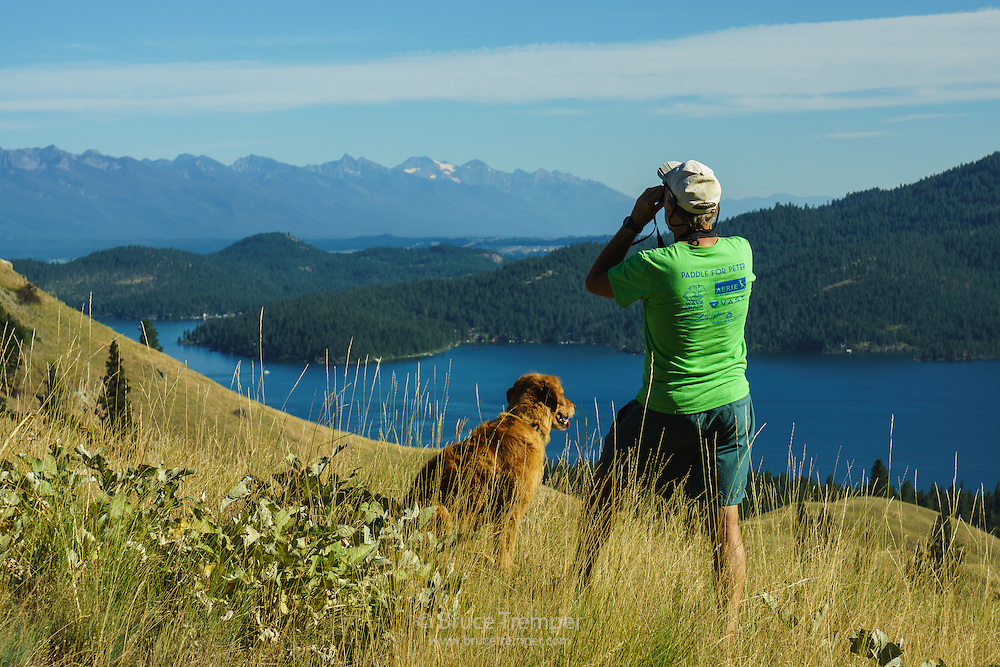 Bruce Maxwell and his dog, Lupine, spotting mountain sheep on Wild Horse Island, Montana