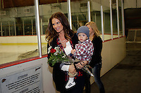 14 December 2012: Tiffany Parros with their son Jagger.  NHLPA players skated in a Charity Game at The Rinks -Anaheim Ice benefiting the Jr. Ducks Pee Wee AAA team and The Children's Hospital of Orange County.  The players skated 4 on 4 with a standing room only capacity of fans with over 500 tickets sold. The White team won the game 10-6 in a Ducks vs Kings lineup.  The NHL is in its 92nd day of locking out their players.