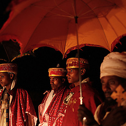 Addisu, 23, stands between priests on his wedding day near Bahir Dar, Ethiopia on Feb. 4, 2008. Addisu and his new bride Destaye, 11, married in a traditional Ethiopian Orthodox wedding ceremony. Community members say that Destaye was married to Addisu at such a young age because, as a priest, it was necessary his bride be a virgin. According to the United Nations Population Fund, UNFPA, 37 percent of young women in sub-Saharan Africa aged 20 to 24 were married before turning 18. In 2010, there were 13.1 million girls married by age 18 in sub-Saharan Africa and the number is expected to rise to 15 million by 2030.