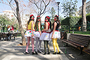 Israel, Tel Aviv, Purim celebration March 2008 four 17 year old girls dressed up as clowns