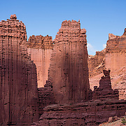 The impressive Fisher Towers are eroded from Cutler sandstone capped with Moenkopi sandstone, on BLM federal land near Moab, Utah, USA. Hike the Fisher Towers Trail 4.5 miles round trip with 800 feet gain. The Bureau of Land Management (BLM) is an agency within the United States Department of the Interior that administers American public lands.