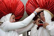 Carnival Association President's wife (at right) and her niece prepare their mushroom suits to take the children to Sunday?s dance. In Cabanas de Viriato parents encourage children to participate on the festivities, and they are more than happy to do it.