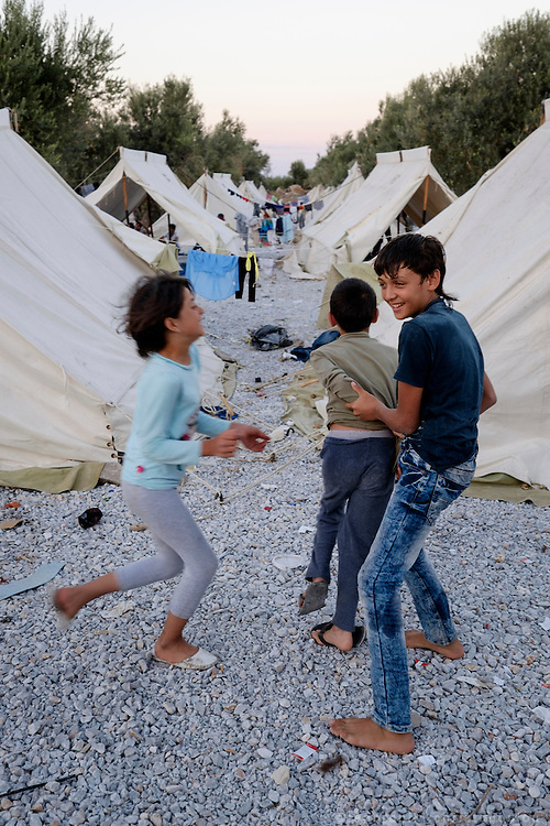 Kids playing by the tents.<br /> Refugee camp Kara Tepe near Mytilene city. It hosts Syrian refugees who are waiting for their registration papers that will allow them to stay in Greece for some time till they can move to an other European country.