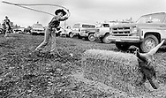 Using a straw bale for a target, a young competitor gets in some rope practice before going in to compete in the Cloverdale Rodeo.&amp;#xD;&amp;#xD;Cloverdale, BC.<br />