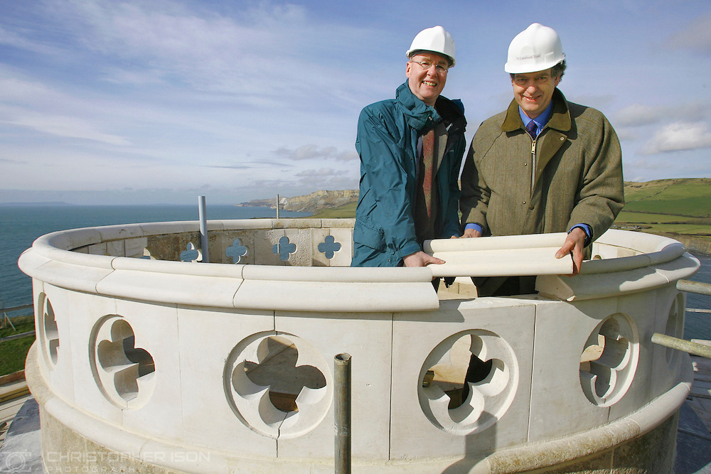The final stone is placed on the rebuilt Clavell Tower during a topping out ceremony conducted by Peter Pearce, director of the Landmark Trust (right) and Adrian Tinniswood, chair of the South West Committee for the Heritage Lottery Fund. Clavell Tower was perched perilously close to the cliff edge at Kimmeridge Bay in Dorset and was at risk of falling into the sea due of coastal erosion. An 18-month project, costing £898,000, has seen the 1830 monument along the World Heritage Site dismantled by specialist builders with each of the 16,272 stones numbered and recorded. The four-storey ruin was then rebuilt 82ft further inland using as much original material as possible.