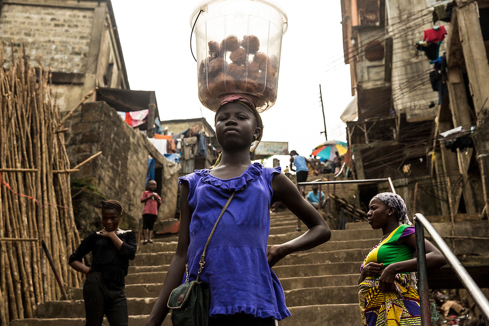 Freetown, Sierra Leone. Daily life in the suburbs of Susan's bay community. Photo Martine Perret. 14 December 2014