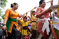 Women walk in a religious Hindu parade in Ubud, Indonesia.