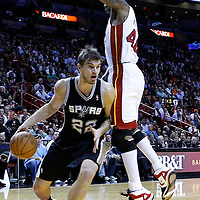 17 January 2012:  San Antonio Spurs forward Tiago Splitter (22) dries past Miami Heat power forward Udonis Haslem (40) during the Miami Heat 120-98 victory over the San Antonio Spurs at the AmericanAirlines Arena, Miami, Florida, USA.