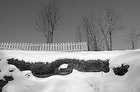 Fence on a Snow Covered Hill in Tromsø, Norway. Image taken with a Leica X2 camera (ISO 100, 24 mm, f/5, 1/320 sec).