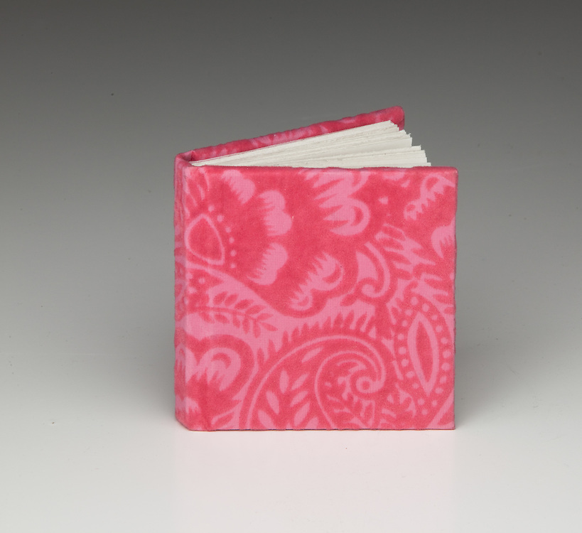Flocked paper for cover on a flat spine binding.