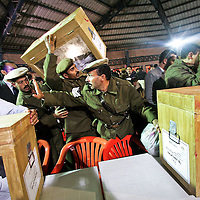 A member of the Egyptian security forces tries to hold back the crowd inside a vote counting area in Al-Mansurah, Egypt. The final phase of Egypt's month-long parliamentary polls kicked off amid high tension, with the Muslim Brotherhood and the country's judges determined to resist state interference. December 2005.