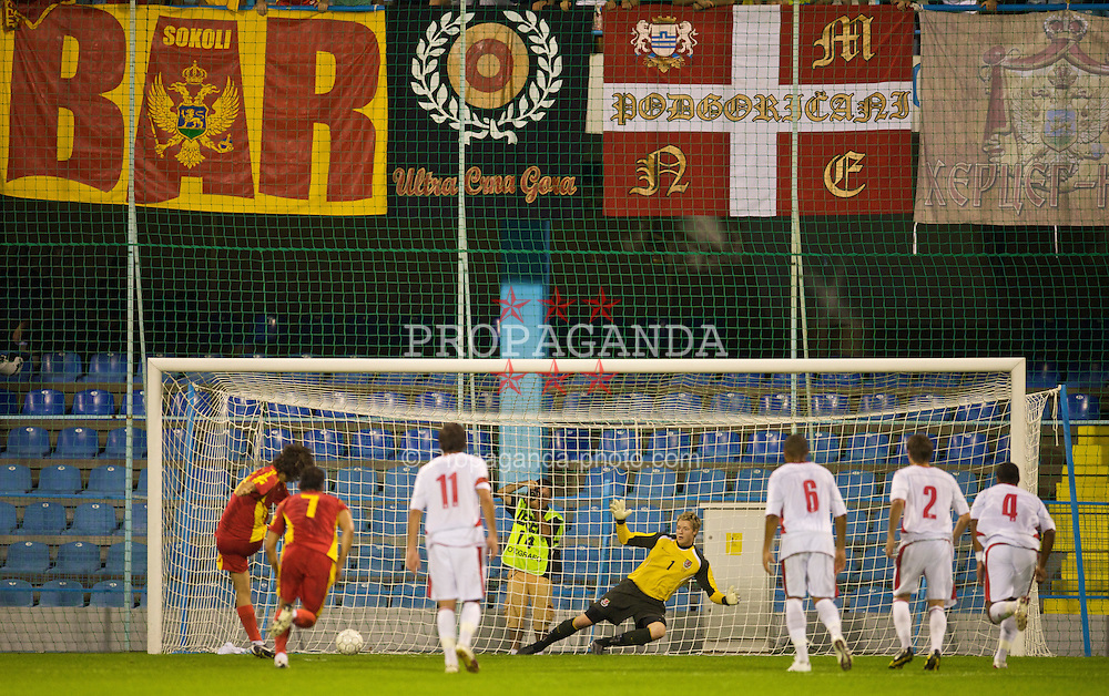 PODGORICA, MONTENEGRO - Wednesday, August 12, 2009: Wales' goalkeeper Wayne Hennessey is beaten by Montenegro's Stevan Jovetic for the the opening goal from the penalty spot during an international friendly match at the Gradski Stadion. (Photo by David Rawcliffe/Propaganda)