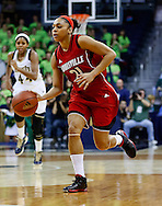 SOUTH BEND, IN - FEBRUARY 11: Bria Smith #21 of the Louisville Cardinals dribbles the ball up court during the game against the Notre Dame Fighting Irish at Purcel Pavilion on February 11, 2013 in South Bend, Indiana. Notre Dame defeated Louisville 93-64. (Photo by Michael Hickey/Getty Images) *** Local Caption *** Bria Smith