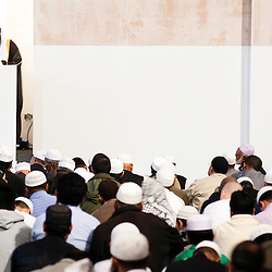 London, UK - 20 July 2012: Imam Sheikh Abdul Qayum addresses the London's Muslim community on the first day of Ramadan in the East London Mosque, the largest in Britain.