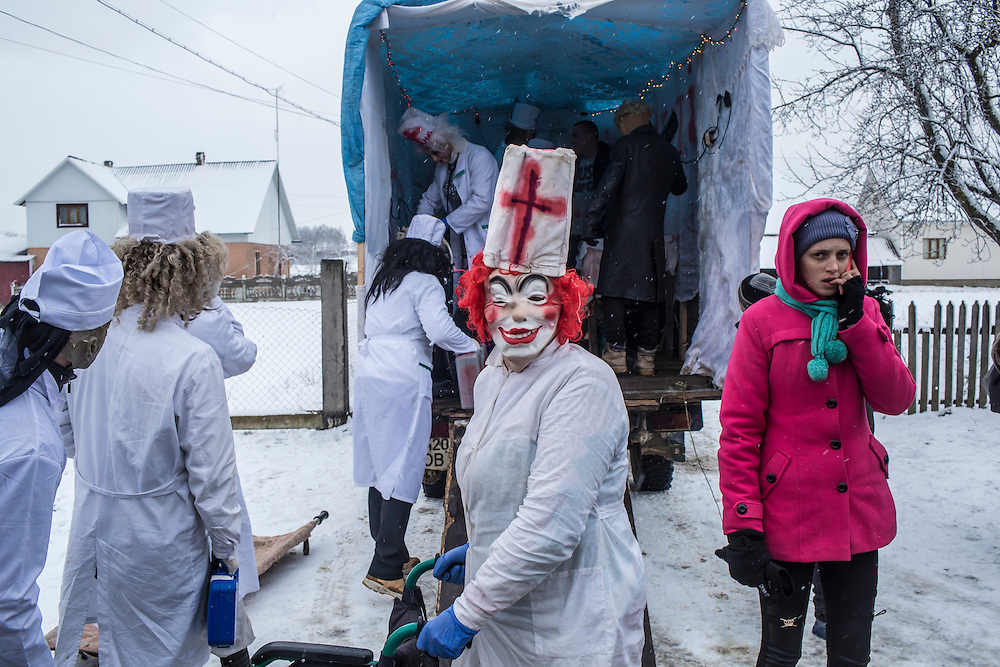Revelers dressed as doctors celebrate the Malanka Festival on Thursday, January 14, 2016 in Krasnoilsk, Ukraine. The annual celebrations, which consist of costumed villagers going in a group from house to house singing, playing music, and performing skits, began the previous sundown, went all night, and will last until evening.