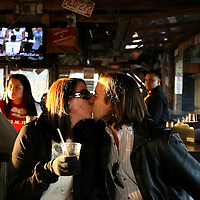 ST. PETE BEACH, FL -- February 13, 2010 -- Michael Symones and his fiance, Ashley Peterson, share a kiss as they have a drink at the PCI Beach Bar at the Postcard Inn in St. Pete Beach, Fla., on Saturday, February 13, 2010.  The beachfront U-shaped hotel, originally built in 1957, was renovated into a throwback surf shack of sorts with rooms featuring surfing imagery and vintage furniture. (Chip Litherland for The New York Times)