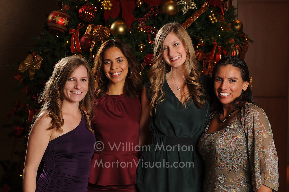 Employees of the Omni San Diego gather for a group portrait at their holiday party. Portraits printed on-the-spot by Dallas event photographer William Morton of Morton Visuals event photography.