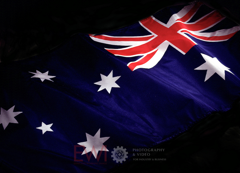 Australian flag coming out of dark background.<br />