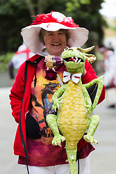 © Licensed to London News Pictures. 21/04/2017. LONDON, UK. A woman with a dragon in Leadenhall Market in the City of London today, ahead of the official St George's Day this Sunday. Photo credit: Vickie Flores/LNP