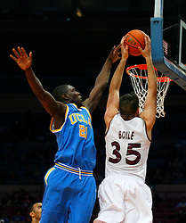 Nov 21, 2008; New York, NY, USA; UCLA Bruins guard Jrue Holiday (21) blocks a shot by Southern Illinois Salukis forward Tony Boyle (35) during first half action of the 2K Sports Classic consolation game at Madison Square Garden.