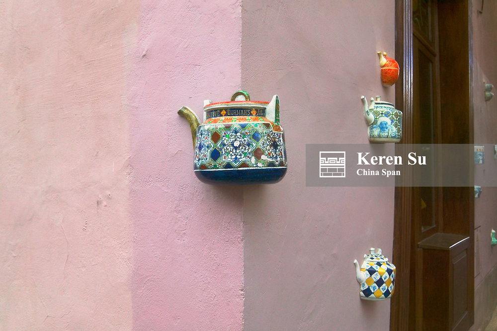 Wall decorated with teapot in the old town, Vilnius, Lithunia