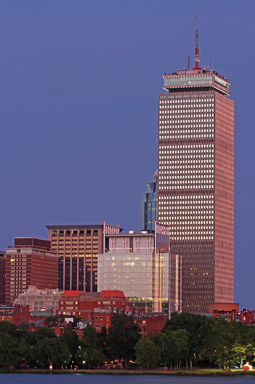 Boston architecture photography of the Back Bay skyline showing historic and modern architectural landmarks such as the Prudential Center and the newly constructed glass building at 330 Beacon Street Corporation on a beautiful night at twilight.<br />