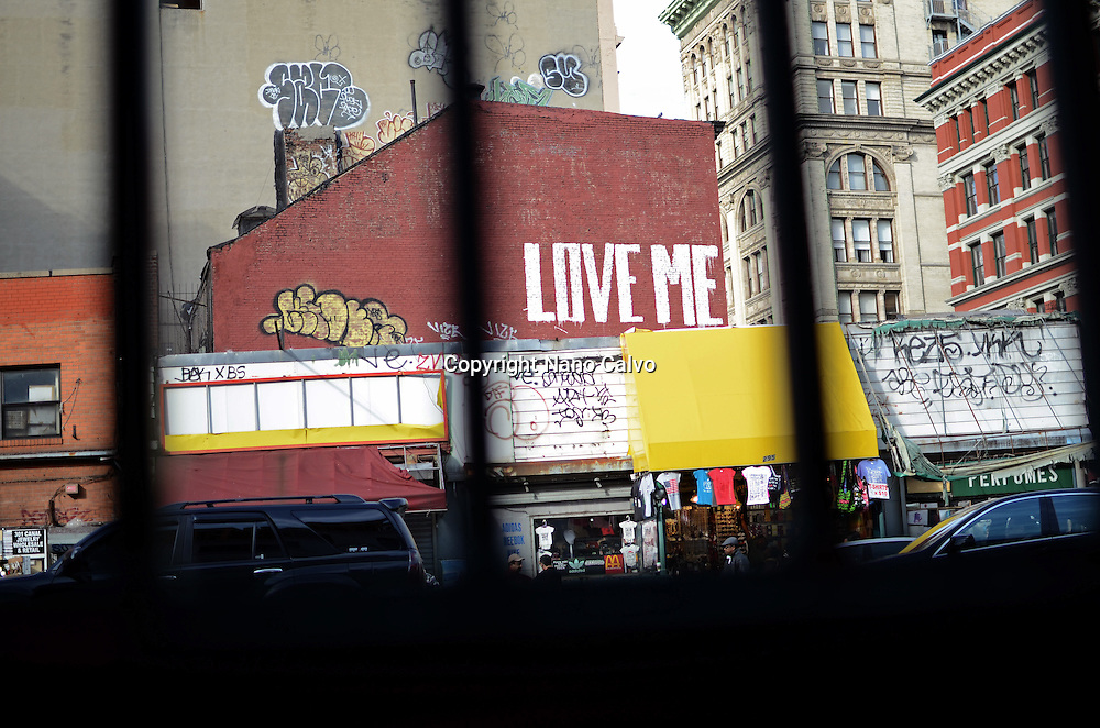 Wall painting that reads Love Me, Chinatown, New York