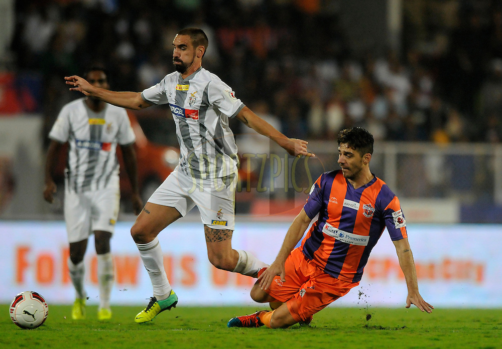 Borja Fernandez of Atletico de Kolkata and Kostas Katsouranis of FC Pune City during match 44 of the Hero Indian Super League between FC Pune City and Atletico de Kolkata FC held at the Shree Shiv Chhatrapati Sports Complex Stadium, Pune, India on the 29th November 2014.<br /> <br /> Photo by:  Pal Pillai/ ISL/ SPORTZPICS