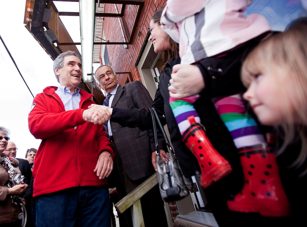 Liberal leader Michael Ignatieff shakes hands with a supporters at a campaign stop at Murree Flowers in London, Ontario, Friday April 29, 2011.<br /> REUTERS/Geoff Robins (CANADA)