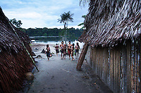 Viriunaveteri, Venezuela. Yanomami indians in their village..The village of Viriunaveteri consists of 15 huts around a muddy square. It's situated in the Venezuelan Amazone several days by boat from the nearest town. This community on the banks of the Casiquiare is one of the few Yanomami villages that actually has some contact with the outside world. Most other tribes live deeper in the jungle.