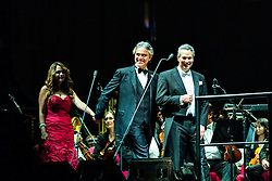 ANAHEIM, CA - JUN 9: Italian tenor Andre Bocelli performed Granada, New York, La Boheme, LaTraviata among others keeping audience mesmerized at the Honda Center in Anaheim, CA. The magical night included producer David Foster on Piano, Violinist Caroline Campbell, American Idol Season 3 winner Soul Singer Fantasia, Cuban Soprano Maria Aleida and Orchestra Conductor Eugene Kohn. Cuban soprano Maria Aleida (L), Italian soprano Andrea Bocelli (C) and conductor Eugene Kohn (R) enter the stage. All fees must be agreed prior to publication, Byline and/or web usage link must  read  PHOTO: SilvexPhoto.com