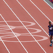 PIC SHOWS  OMAR HASSAN WHO FINISHED LAST AND NEARLY THREE TIMES SLOWER THAN THE WINNER IN THE 1500M T46 RACE AT THE PARALYMPICS BUT RECEIVED A STANDING OVATION FROM THE 80,000 CROWD AS HE FINISHED THE LAST TWO LAPS BY HIMSELF AS THE REST OF THE FIELD HAD FINISHED.HIS TIME WAS 11 MINUTES 23 SECONDS,THE WINNER WAS THREE MINUTES 57 SECONDS... Houssein Omar Hassan   an althete from Djibouti who competed in the 1,500 metres in the 2012 Paralympic Games in London in the T46 category. He was the first representative from Djibouti to compete at the Paralympic and his nation's only athlete in 2012. He finished last in his heat, recording a time of 11:23.50, nearly three times the time of the winner