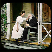 """""""The Image of Her"""" a pretty young woman with an elderly bearded man in a rocker on his porch. Vintage photo circa 1910."""