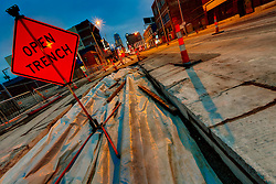 Open trench along Main Street in downtown Kansas City, Missouri's Crossroads District area during construction of the streetcar line.