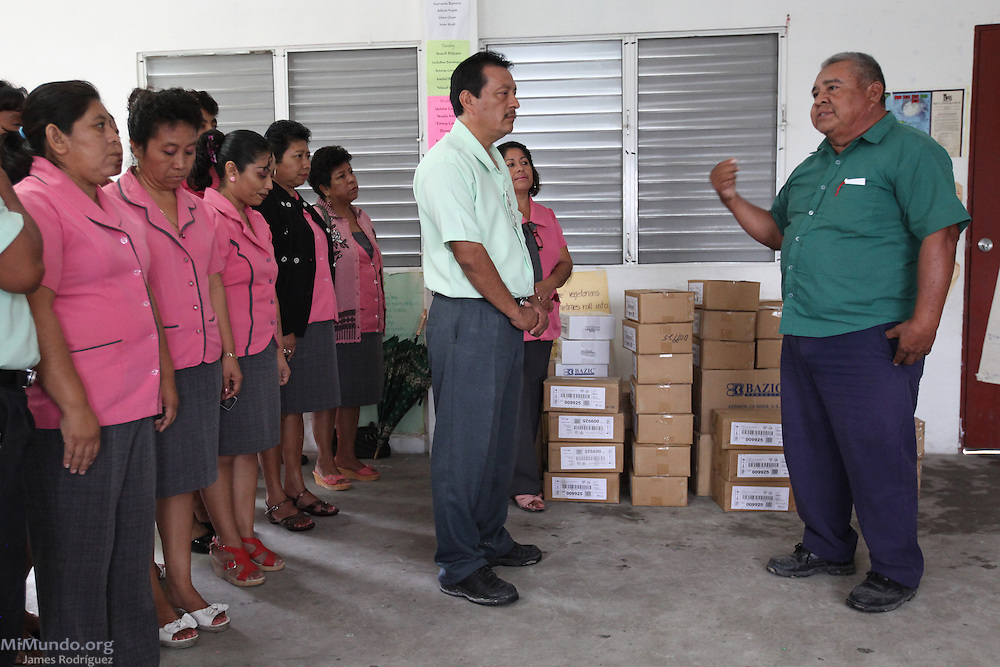 Adolfo Pat (right), BSCFA chairman of the San Narciso branch, presents teachers of the San Narciso Roman Catholic school with educational materials for 560 students. All materials were donated by the BSCFA and paid with the Fairtrade premium. Belize Sugar Cane Farmers Association (BSCFA). San Narciso, Corozal, Belize. January 23, 2013.