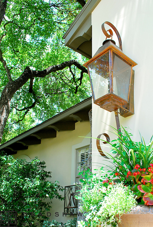 ALAMO HEIGHTS - GAS LANTERNS AND CORBELS UNDER EAVES ADD CHARMING SPANISH COLONIAL DETAILS