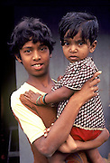 SRI LANKA, PEOPLE Portrait of children in front of Municipal Maternity and Welfare Ctr
