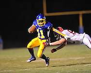 Oxford High's Glenn Gordon (11) vs. Jackson Prep's Healy Vise (82) in Oxford, Miss. on Friday, August 23, 2013. Oxford won 32-20.