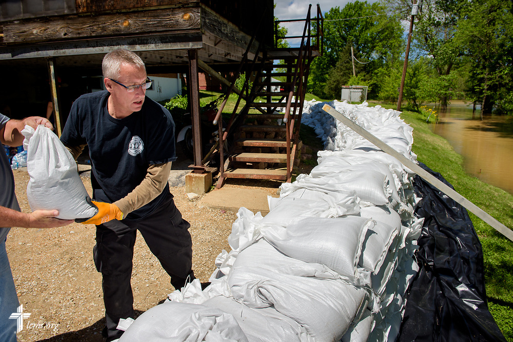 Jon Houser, son of St. John's Lutheran Church, Arnold, Mo., church member Ruth Houser, sandbags her home with the help of fellow volunteers from the church at her home on Tuesday, May 2, 2017, in Arnold, Mo. LCMS Communications/Erik M. Lunsford