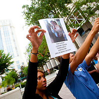 Spectators, law enforcement officers and members of the media gather outside of the Orange County Courthouse prior to the start of sentencing proceedings for Casey Anthony in Orlando, Florida July 7, 2011. Earlier in the week, Anthony, 25, was acquitted of first-degree murder in the 2008 death of her 2-year-old daughter Caylee following 33 days of testimony.